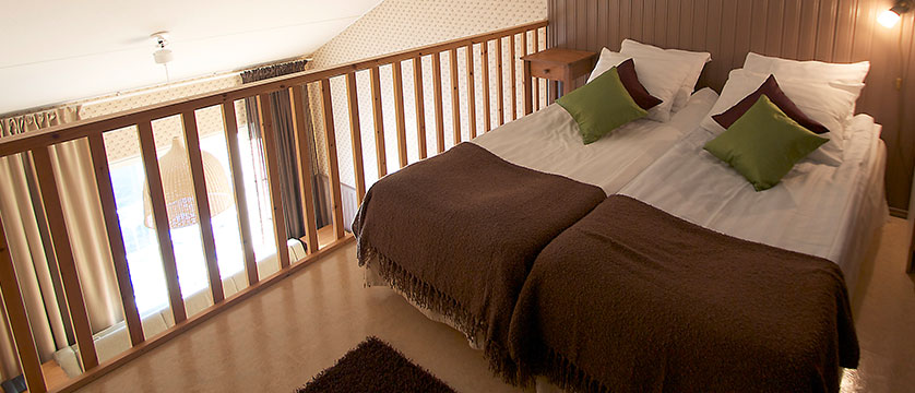 Crazy_Reindeer_Hotel_family-suite-mezzanine-beds-in-white-reindeer-building.jpg
